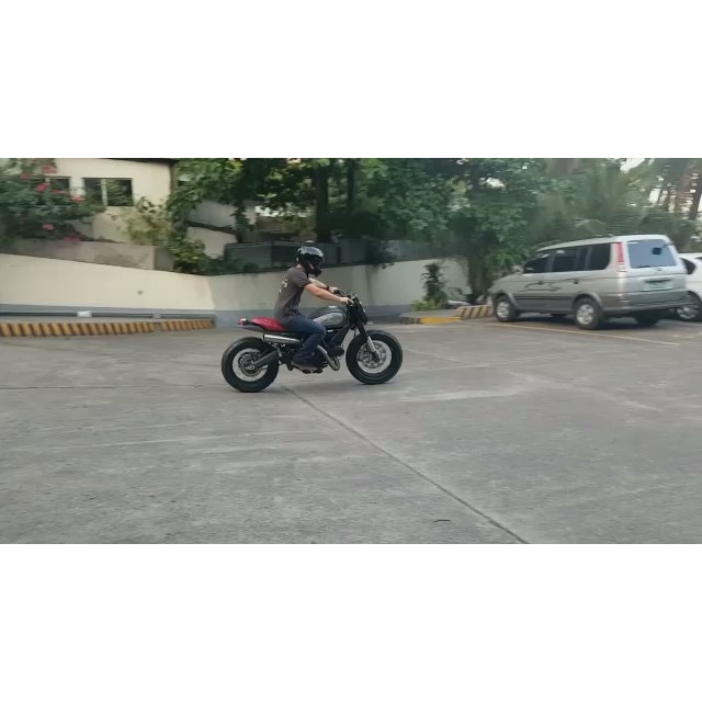 @billyjoecrawford rides his @ducatiphilippines Scrambler around the parking lot !!! Thanks to @stokedinc 😎